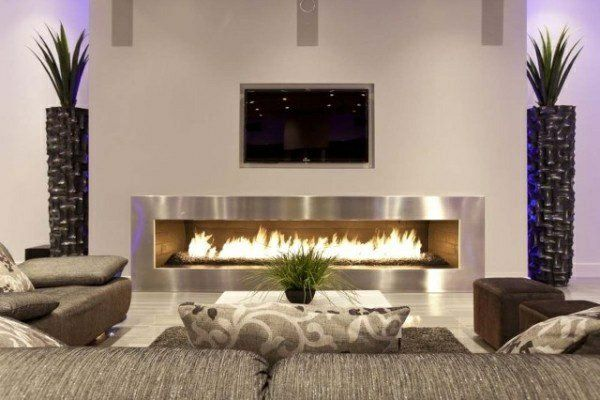 Design wohnzimmer  wohnzimmer design mit einem kamin und deko-pflanzen - Wie ein ...