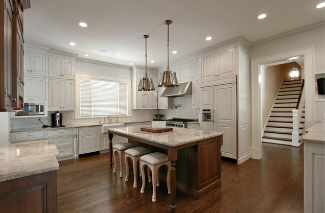 White kitchen with silver pendant lights |