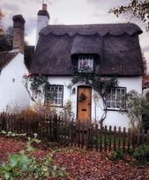 wee cottage with a thatched roof