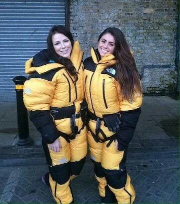 Two pretty girls yellow downsuit