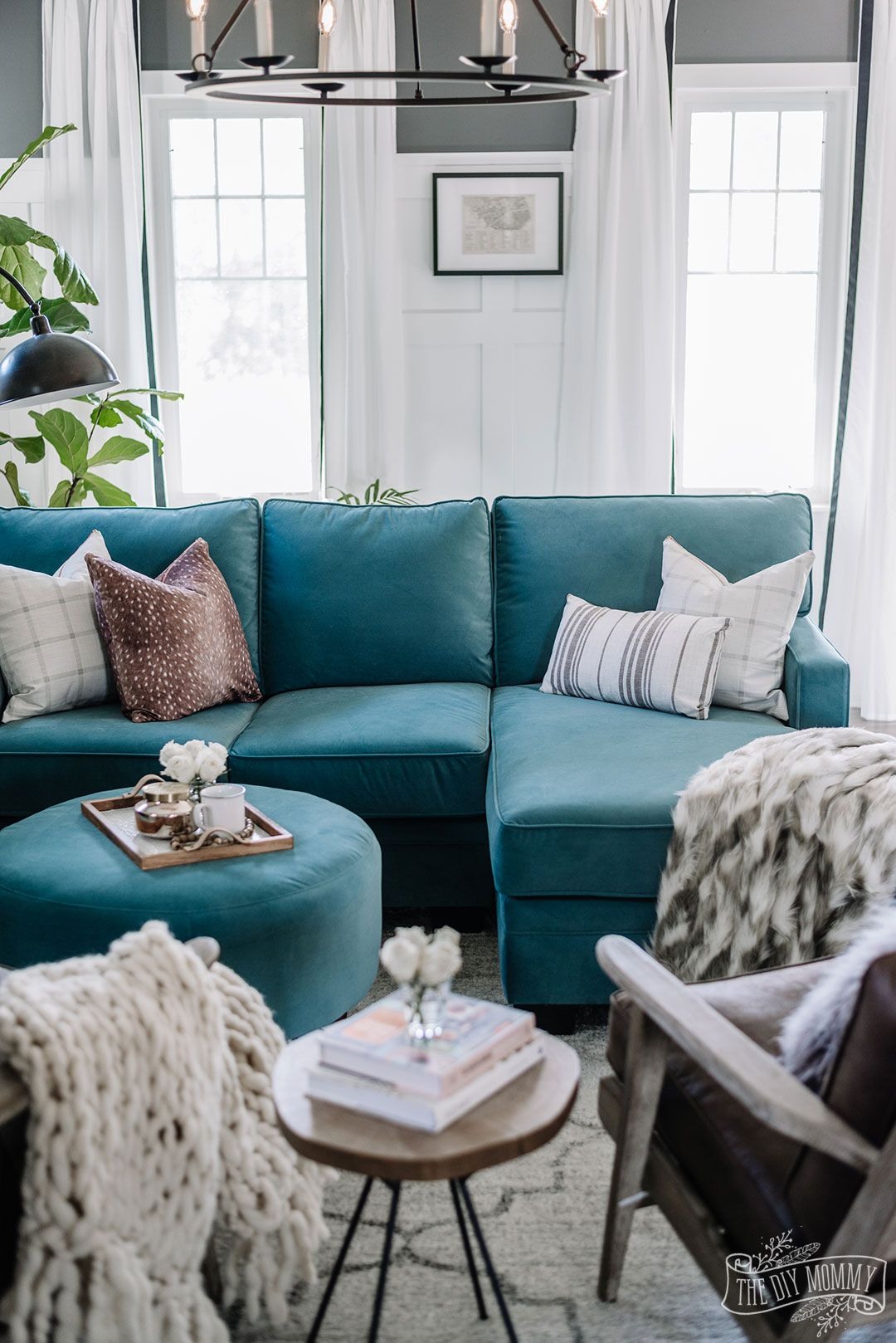 Eclectic Living Room With Teal Velvet Sofa Brown Leather Chairs And Black And In 2020 Teal Sofa Living Room White Living Room Colors Furniture Placement Living Room #teal #and #white #living #room