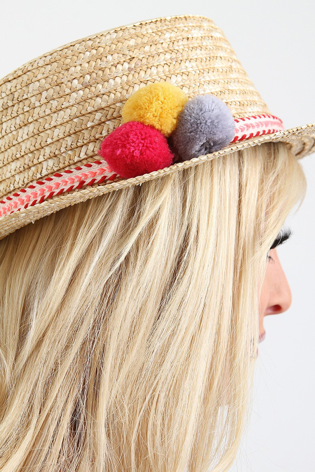 00eb4f90 Pom Straw Boater Hat. This summer time straw hat features a boater style  design, structure round brim, braid trim accent with pom poms, and inner  ribbon ...