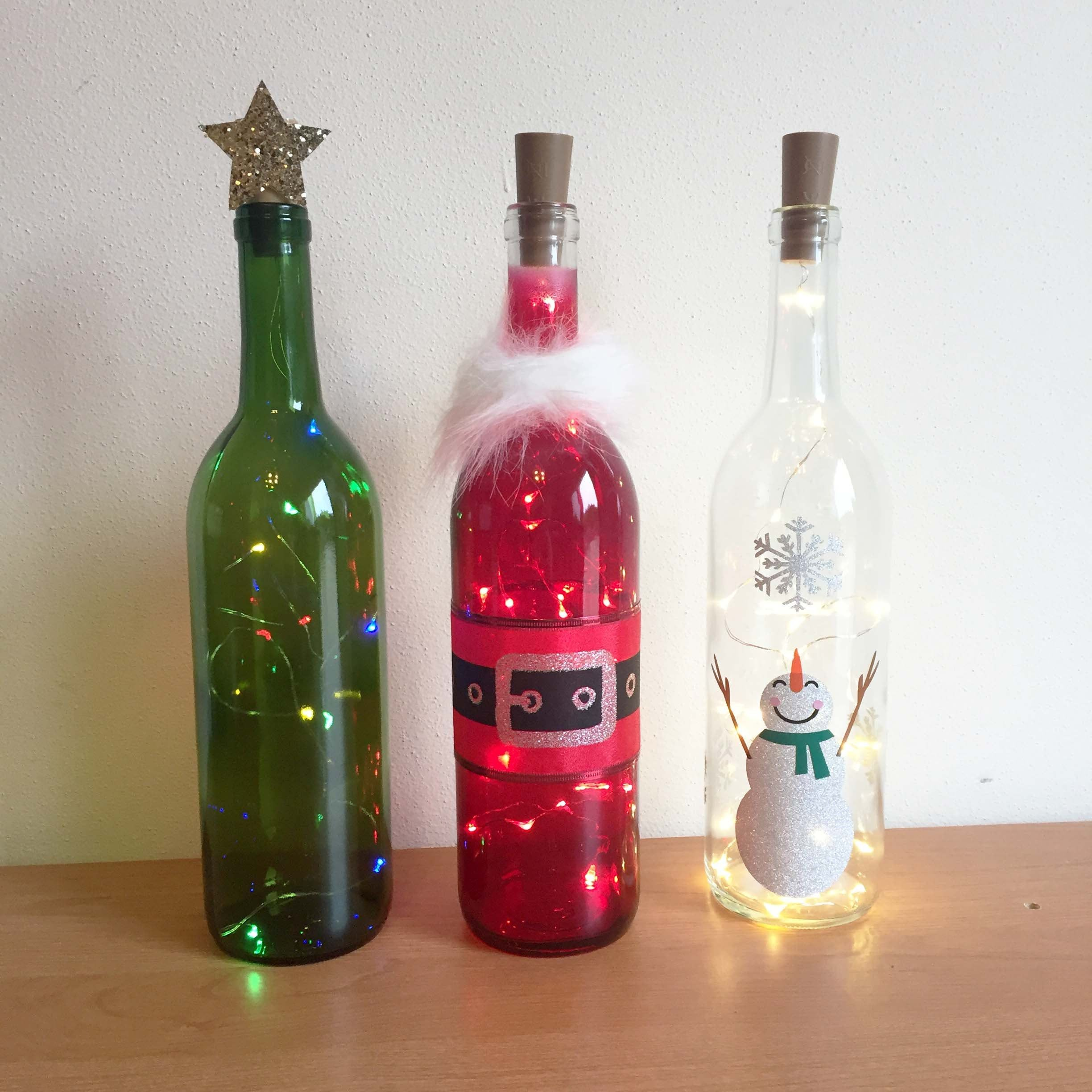 Holiday Wine Bottle Decorations With Lights Santa Snowman Etsy Bottles Decoration Wine Bottle Decor Halloween Wine Bottle Decorations