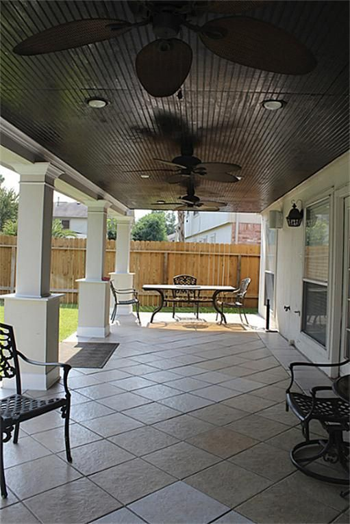 Another View Of The Patio With Fans And Recessed Lighting