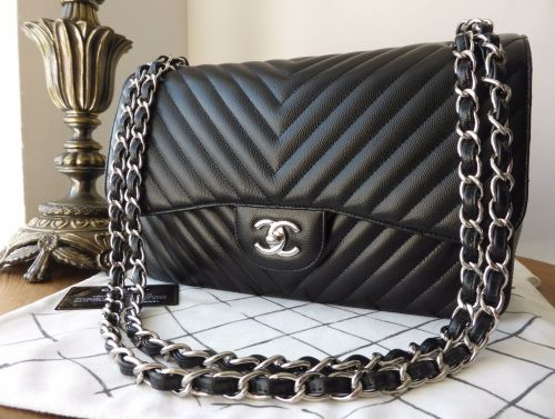 103294dec48d Chanel Chevron Quilted Classic Jumbo Double Flap in Black Caviar with  Silver Hardware > https