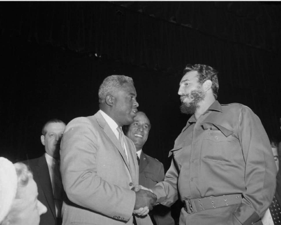 Fidel Castro greets baseball great Jackie Robinson at the Overseas Press Club luncheon.