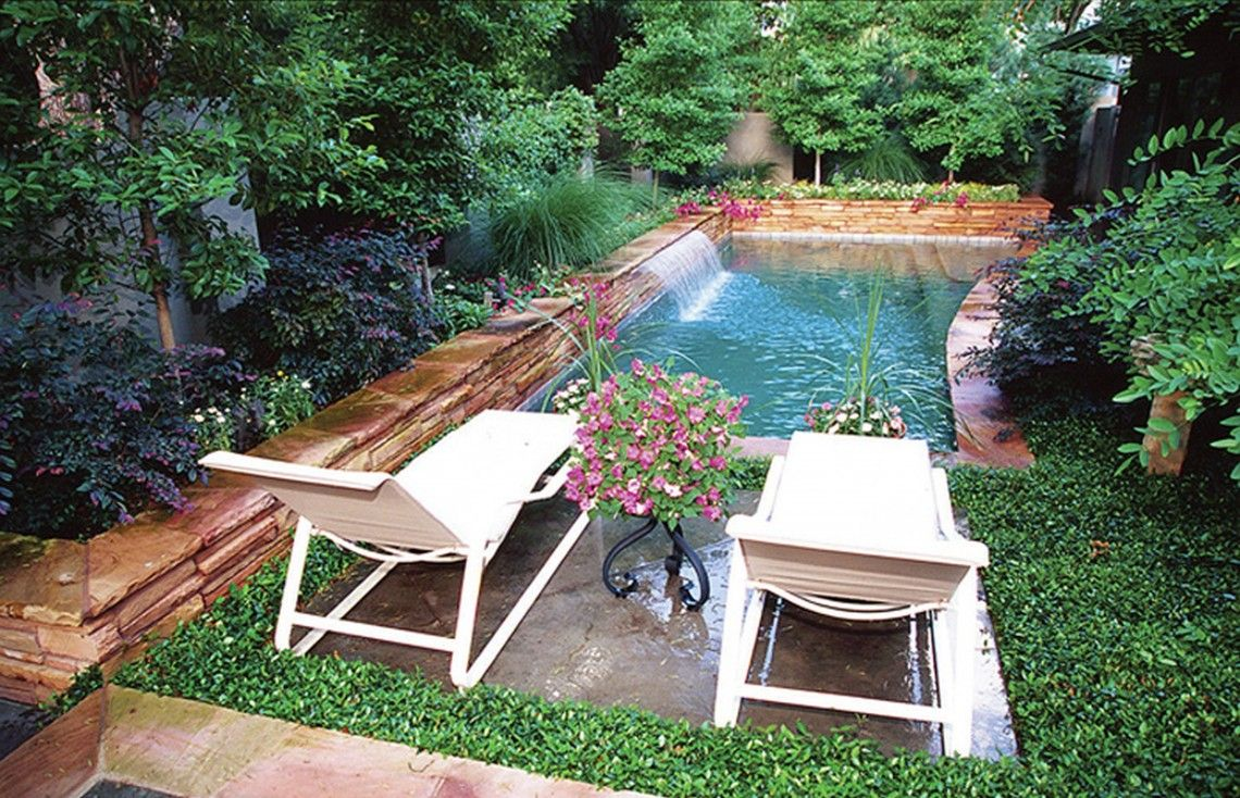 exterior front yard landscape with outdoor pool and white wooden