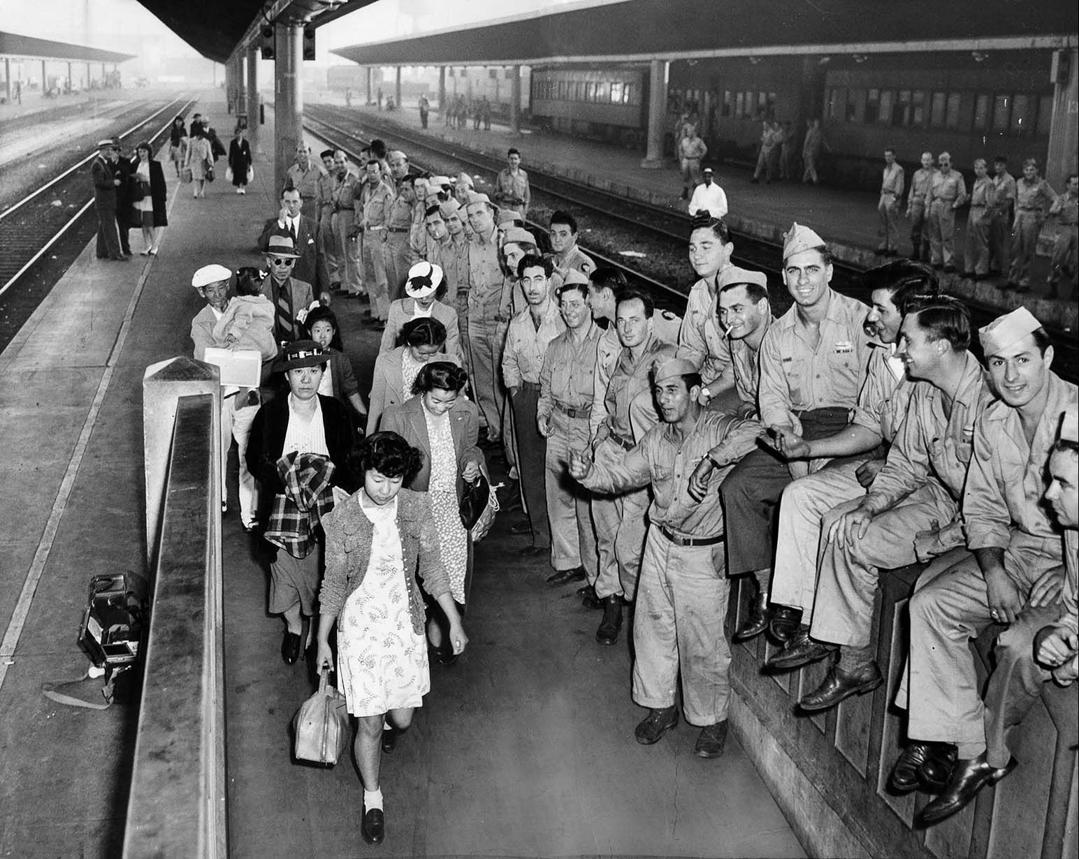 Japanese American Internees Returning From A Relocation