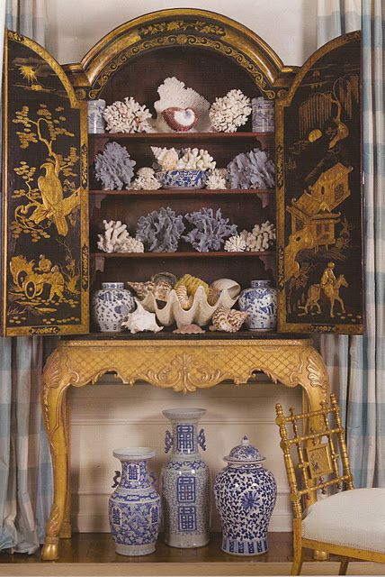 Gorgeous chinoiserie, cabinet on stand, filled with coral, shells, and blue and white. Just fabulous!