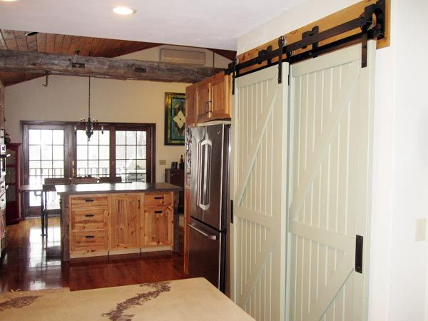 barnstyle sliding pantry doors add character to this farmhouse kitchen - Bypass Barn Door Hardware