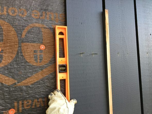 Installing boards for the board and batten siding - use scrap piece of siding as a spacer between boards. #boardandbattensiding Installing boards for the board and batten siding - use scrap piece of siding as a spacer between boards. #boardandbattensiding