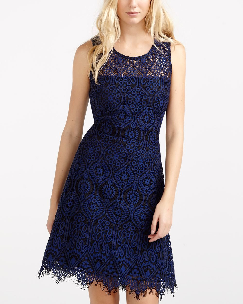 Want to wow on your office holiday party? This Sleeveless Lace Dress makes it hard to wear anything else! This elegant piece features a crew neckline, a fitted top and a flared skirt. Pair it with your favourite high heels and show your groove on the dance floor.