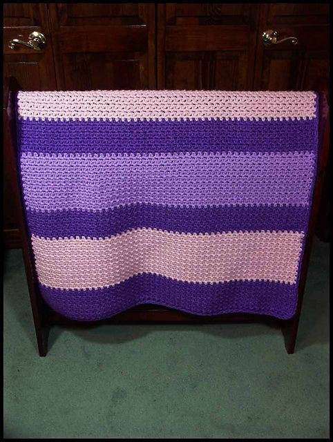 "Soft Granite Blanket (Girls), made with chunky weight yarn, 34"" x 45"". $60 at http://www.ritamiller.com/afghans-baby/ab271-01.html"