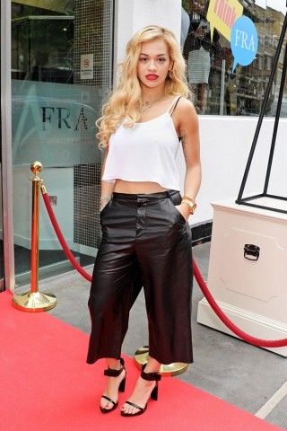 RITA ORA'S CAMI TOP A little skin isn't a sin in this hot weather, so we applaud the lovely songstress Rita Ora for her cropped swing camisole top.