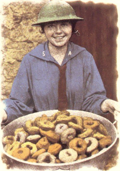 Salvation Army Doughnut Girls served on the front lines in France during World War I. They wrote letters home, darned socks, served doughnuts, sewed on buttons, provided counseling and companionship to American soldiers — many of them away from home for the first time. Doughnuts were made with improvised tin can cutters. All doughnuts were free