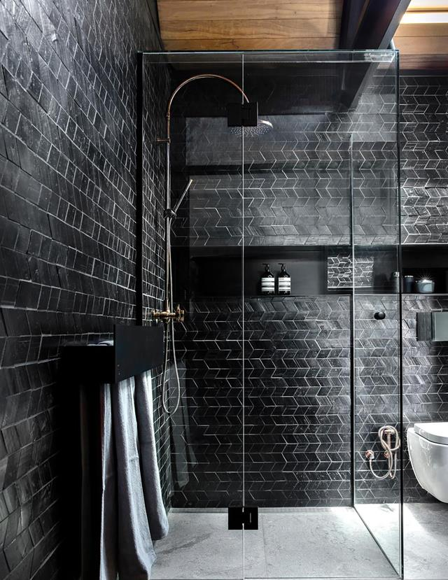 A Moody Bathroom With Black Tiles In 2020 Black Tile Bathrooms Bathroom Interior Design Black Tiles