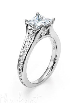 Traditional Diana Solitaire Engagement Ring Like This One Also Features A Channel Set Diamond Band And Surprise Stones Along Side Princess Cut Center