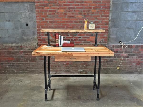 this beautifully crafted standing desk features reclaimed pallets and black iron steel the desktop comprised of a variety of woods