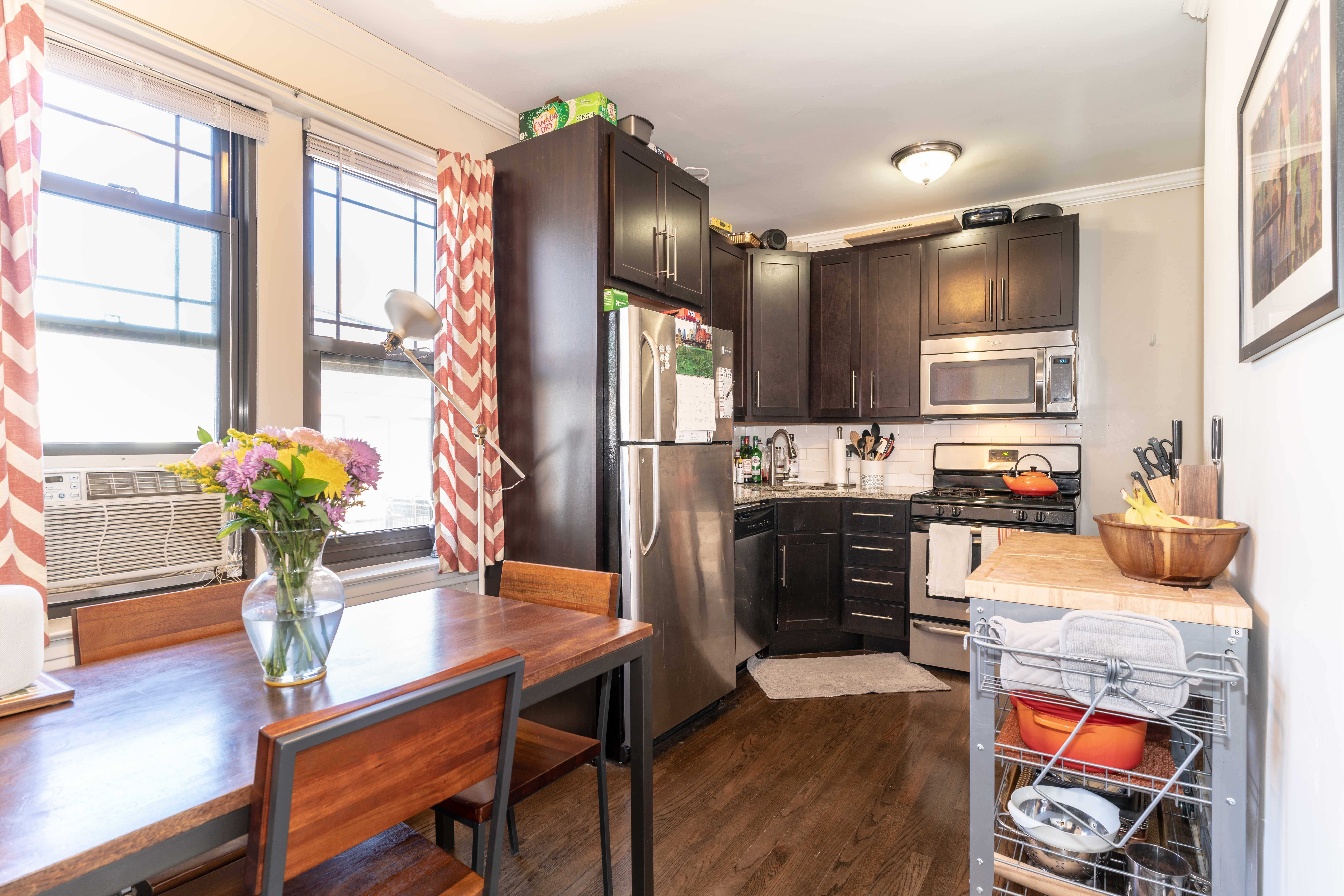 Contemporary kitchen with orange chevron curtains