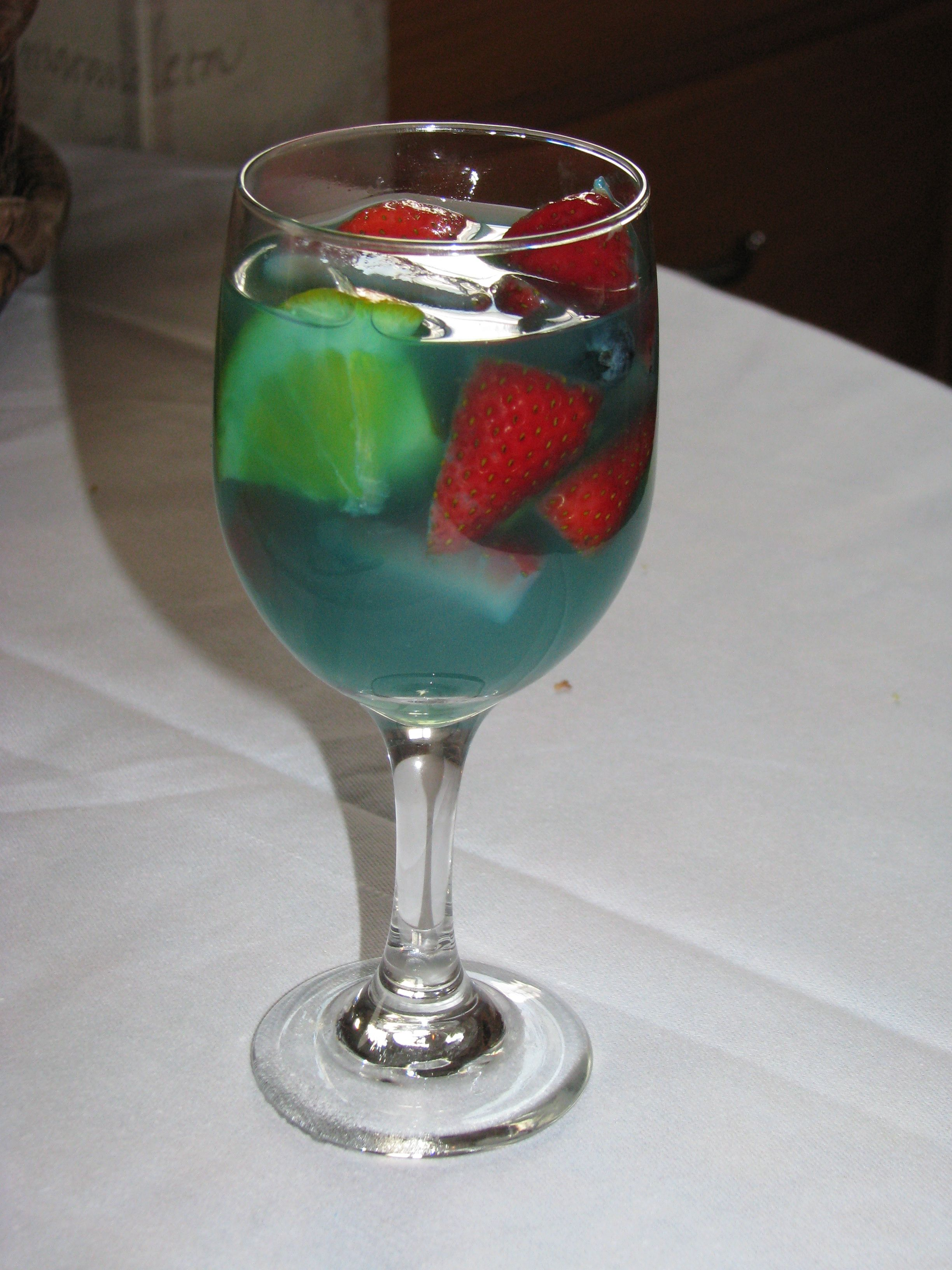 And it was delicious! Blue Sangria for baby boy shower: 1 bottle Cabernet Sauvignon 2/3 cup blue Curacao 1/3 cup Orange Juice 2-4 tablespoons of sugar Mix well, add chopped fruit: strawberries, oranges, apples and blueberries. Chill and serve.