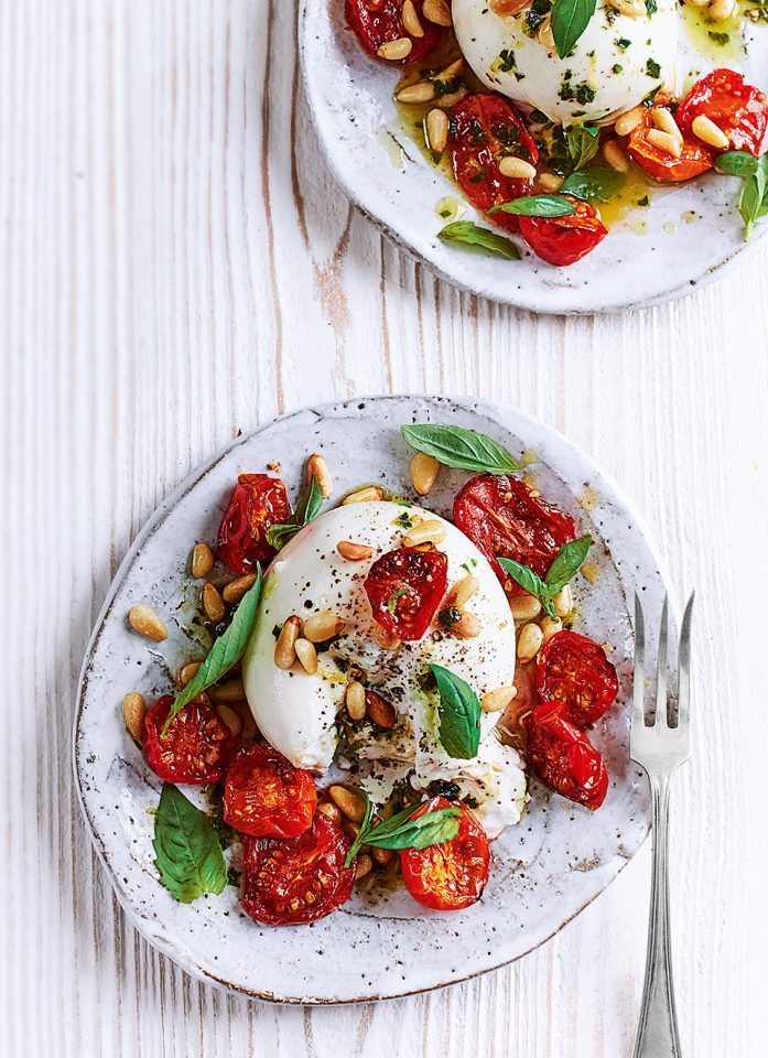 Burrata with sticky roasted tomatoes, pine nuts and basil