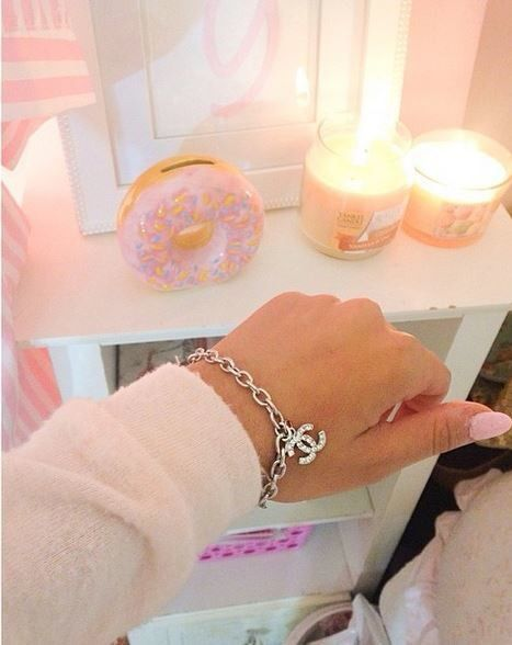 """Everyone's probably thinking """"CHANEL!"""", but honestly, I'm just thinking about the pink donut in the background"""