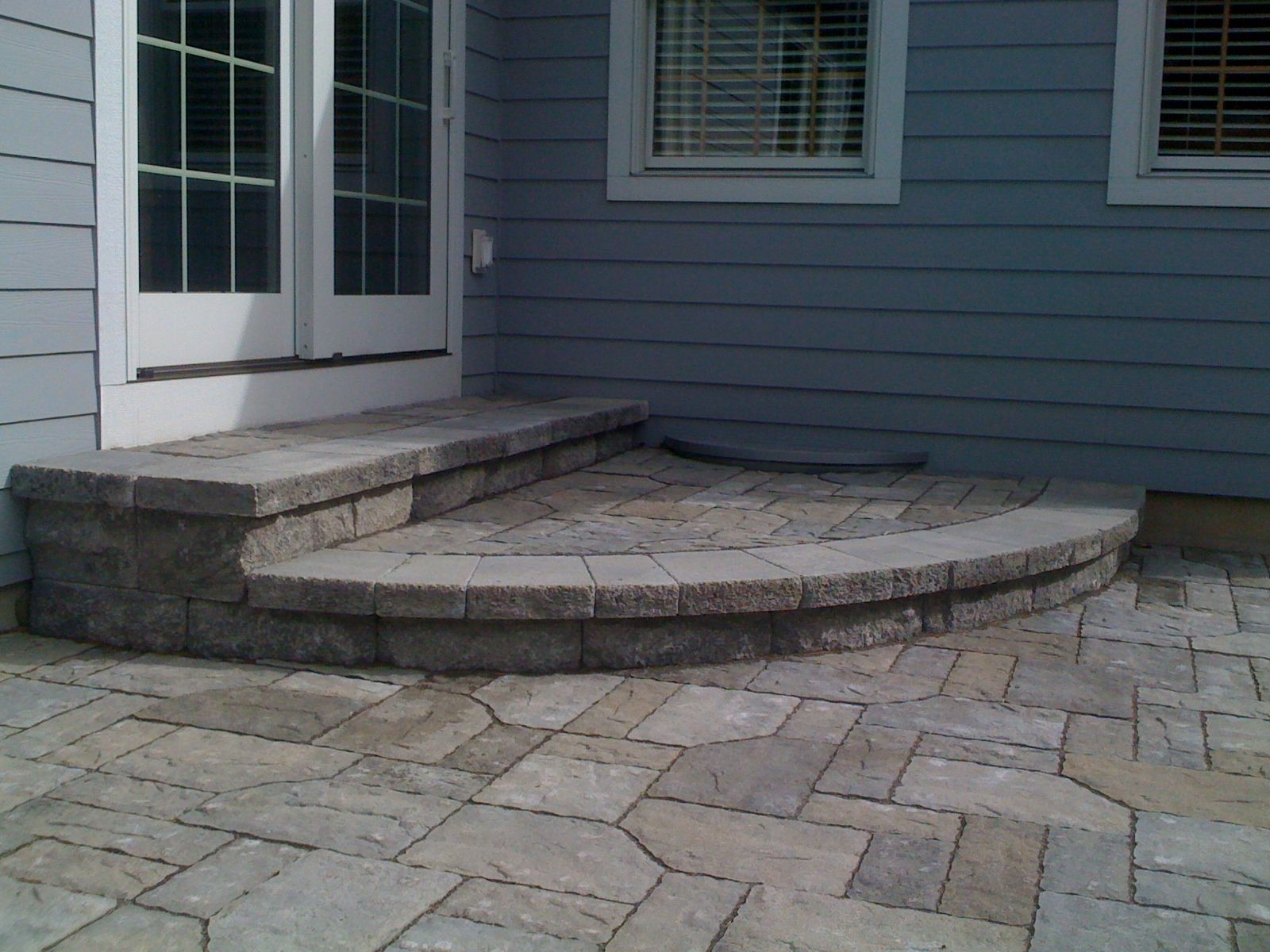 Beautiful Back Porch Stone Steps Coming Down Onto Patio