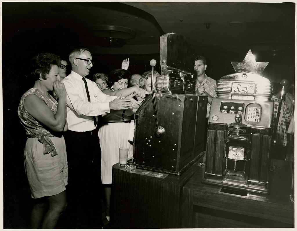 Photograph of people playing slots, Sands Hotel and Casino