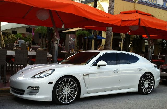 white porsche panamera with custom rims exotic cars on the streets of miami