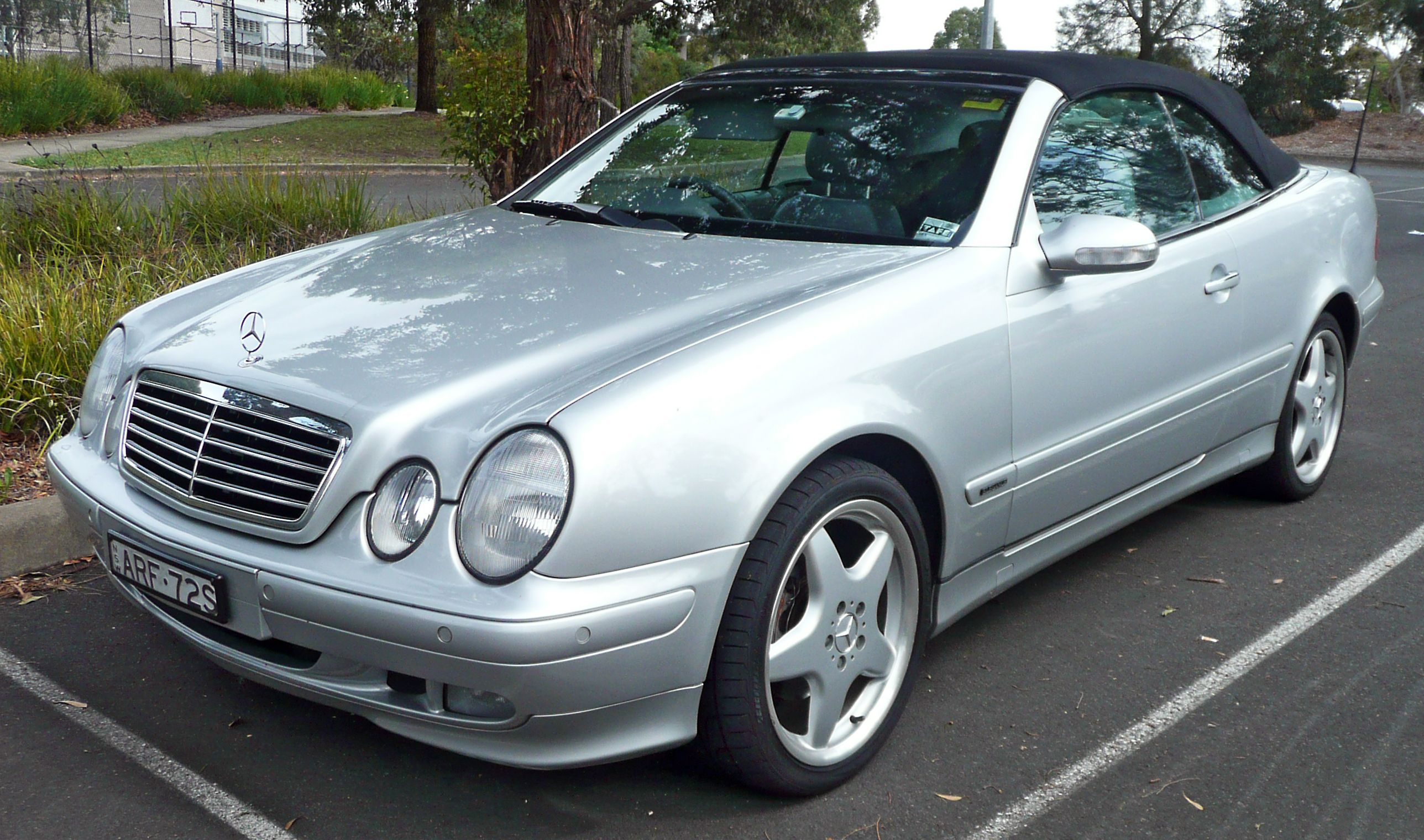 1999 Mercedes CLK 320 convertible. sigh.. I miss this car..this is a 2000  but mine is cuter..it's Periwinkle and a navy rag top..really cute and I  love it ...