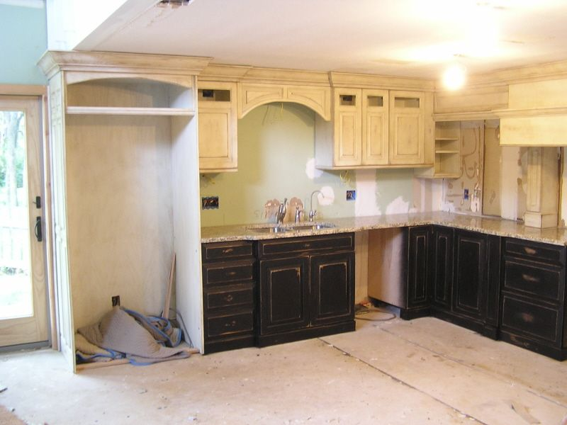 Kitchen Features Black Distressed Base Cabinets With White Distressed