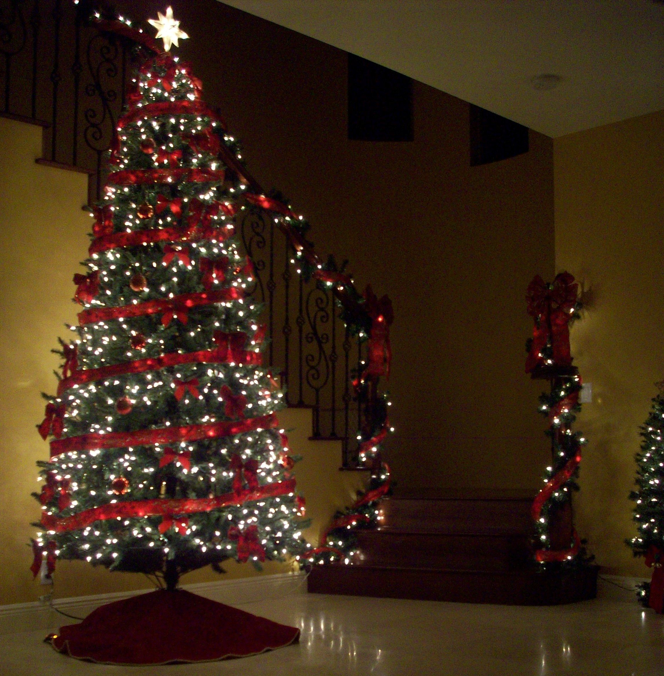 a white lighted christmas tree and lighted garland coming. Black Bedroom Furniture Sets. Home Design Ideas