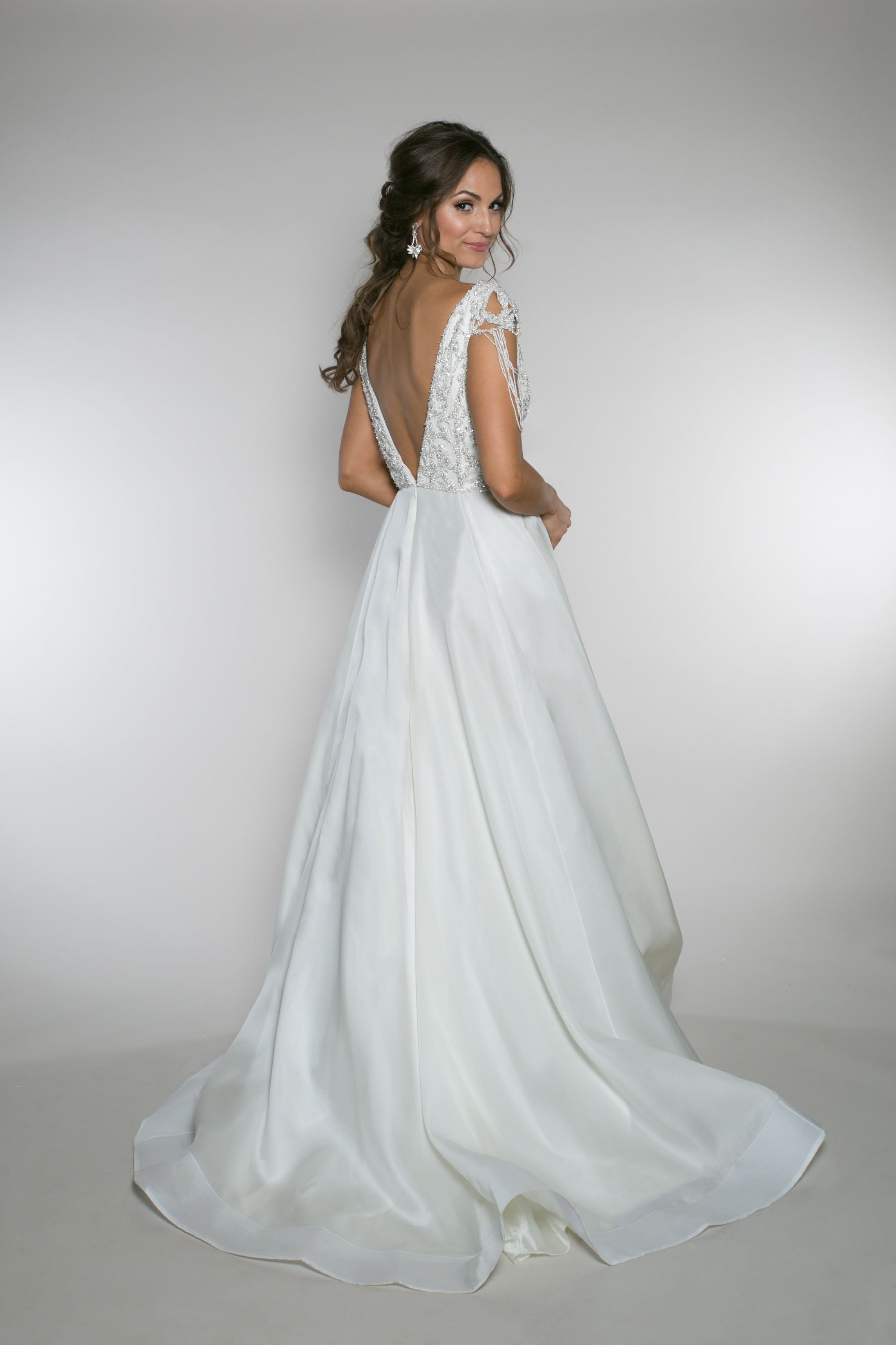 Wedding dresses with rhinestones  Lottie Luxe This aline wedding gown consist of a full beaded