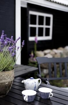 Photo of La Maison Boheme: Black Cottage, White Trim