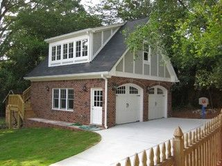 garage detached garage two car garage brick gray shingles white doors stucco board guest house mother in law suite driveway wooden fence