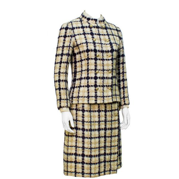 Pre-owned 1960's Chanel Couture Navy & Tan Boucle Suit with Removable... (£3,285) ❤ liked on Polyvore featuring suits, skirt suits and suits outfits and ensembles