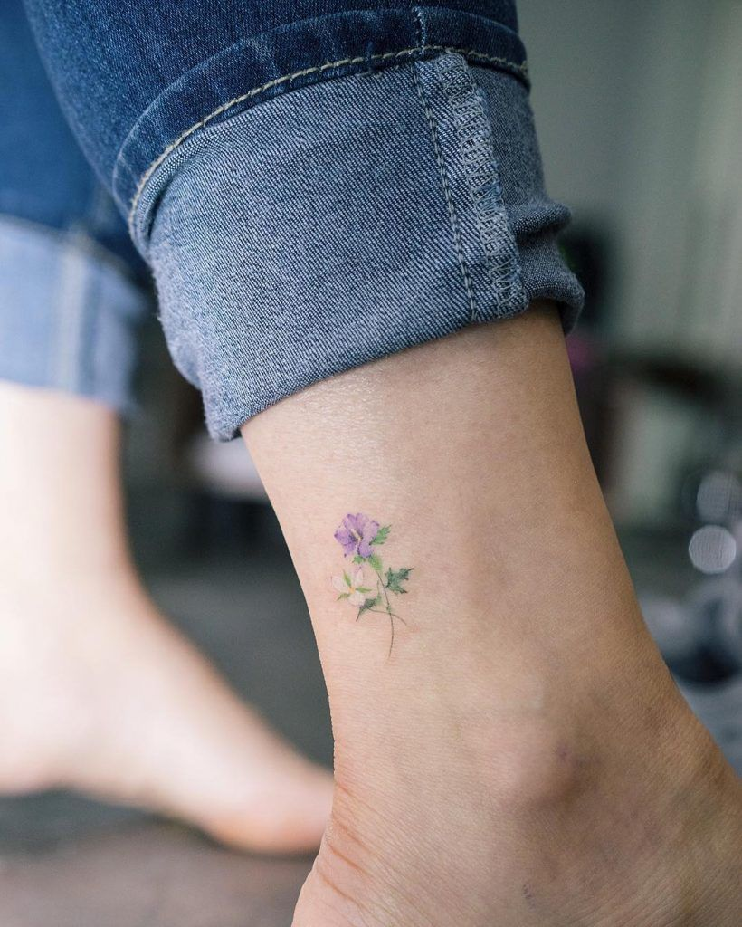 Small Rose of Sharon tattoo inked on the right outer ankle
