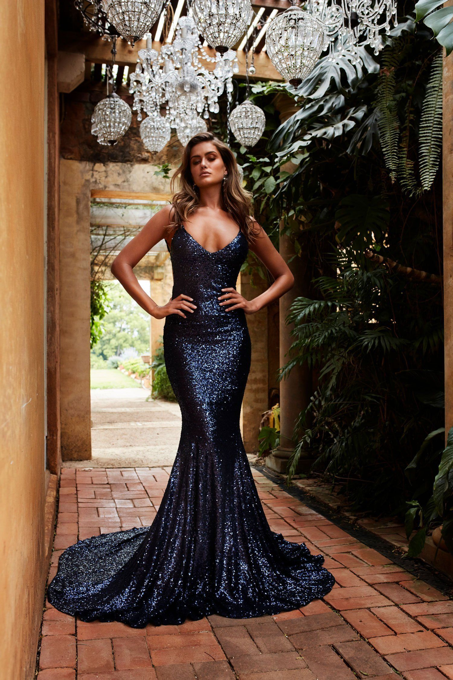 a8ec11440261 Deliver ultimate glam in the Navy Yassmine Luxe sequins gown. This dress  features a plunge v-neckline, thin straps, open back, lined with satin and  padded ...