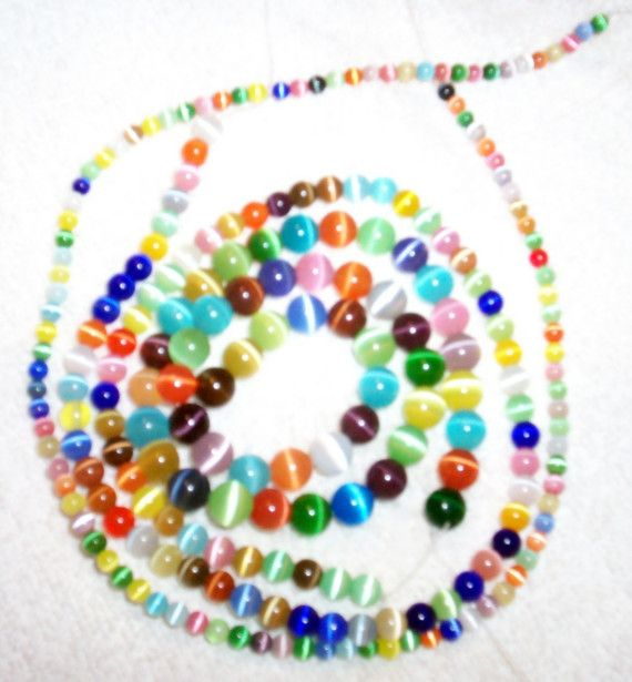 Three strands of Cats Eye Beads by BeadingMommy on Etsy, $5.25