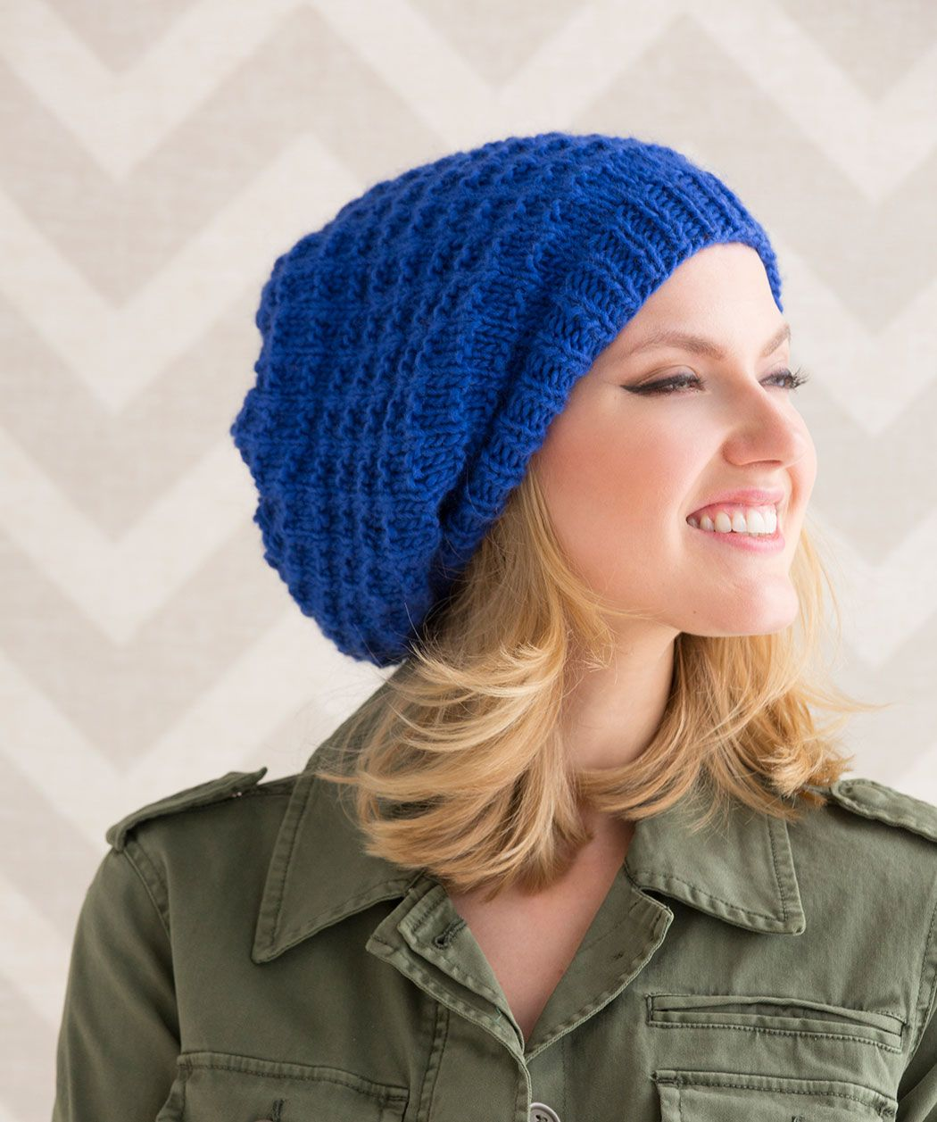 Stay stylish with this classic slouchy hat. A solid colour lets the knit  check stitch stand out. 99223286d775