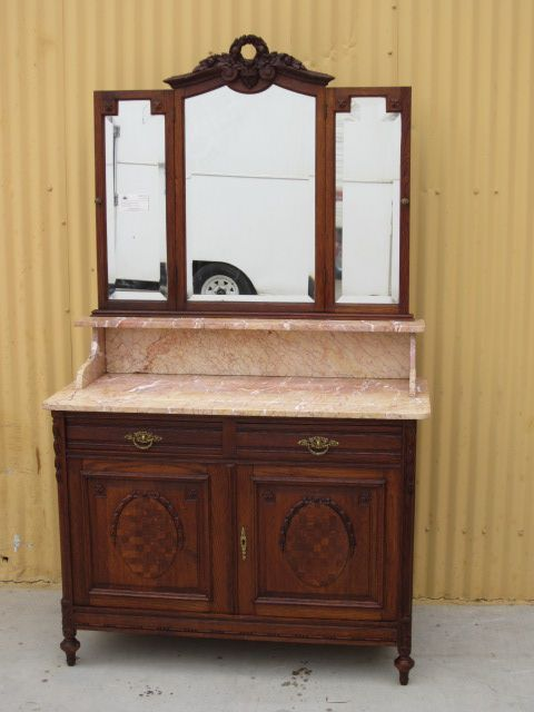 Original French Antique Marble Dresser That Is Hand Carved Out Of Oak And Dates From 1890