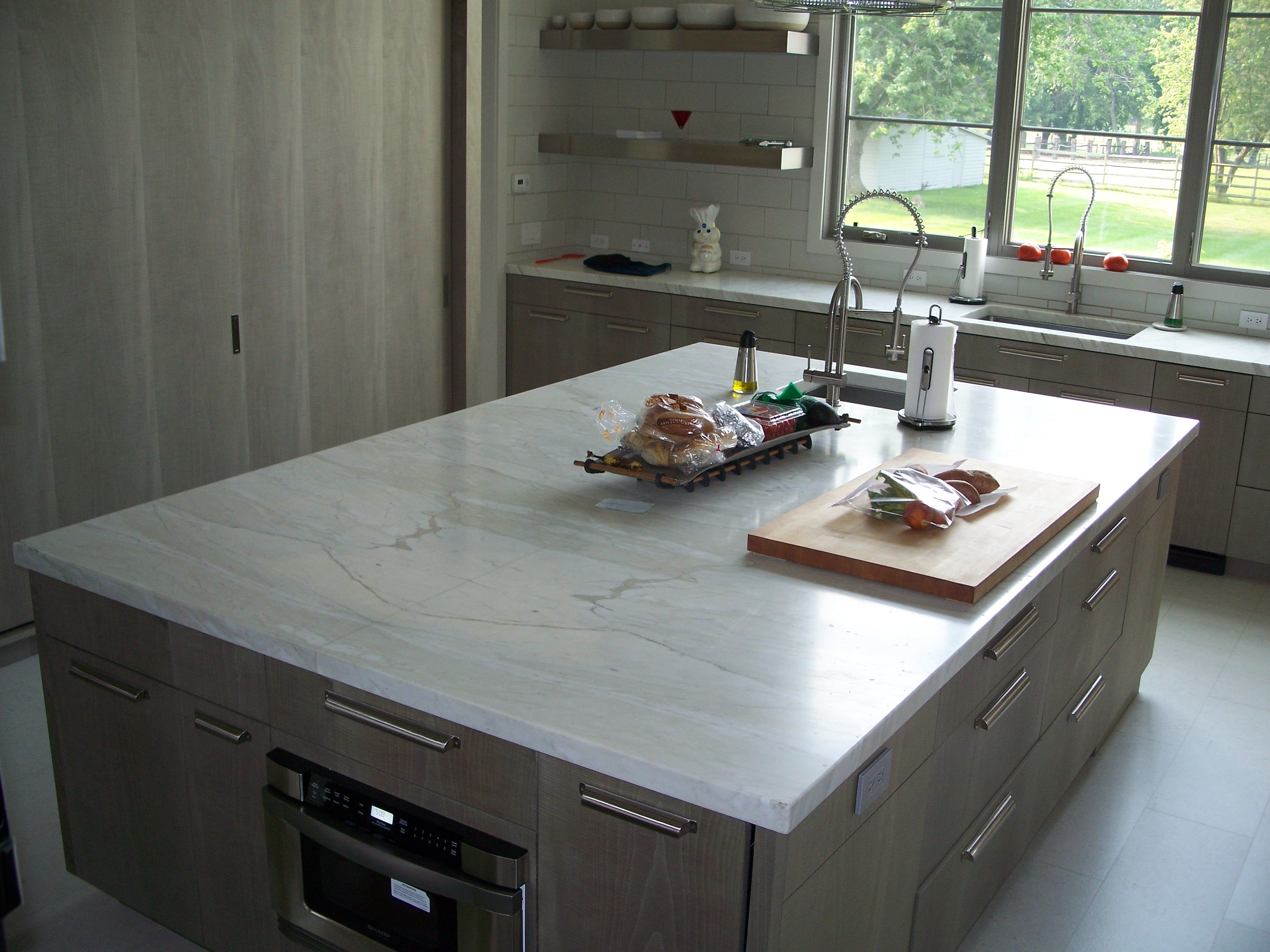 2 Thickness Calacatta Gold Honed Finish Marble Island With Bookmatched Seam Down Center