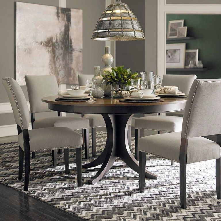 Transitional Dining Room With Columns Hardwood Floors Bassett Furniture Seville Area Rug Round Dining Room Round Pedestal Dining Table Pedestal Dining Table