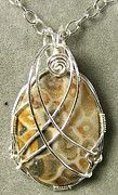 Stone mounted in silver wire