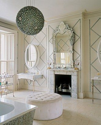 A Victorian-inspired master bath is imbued with a playful sense of scale thanks to oversize mirrors and an unexpected globe chandelier | archdigest.com