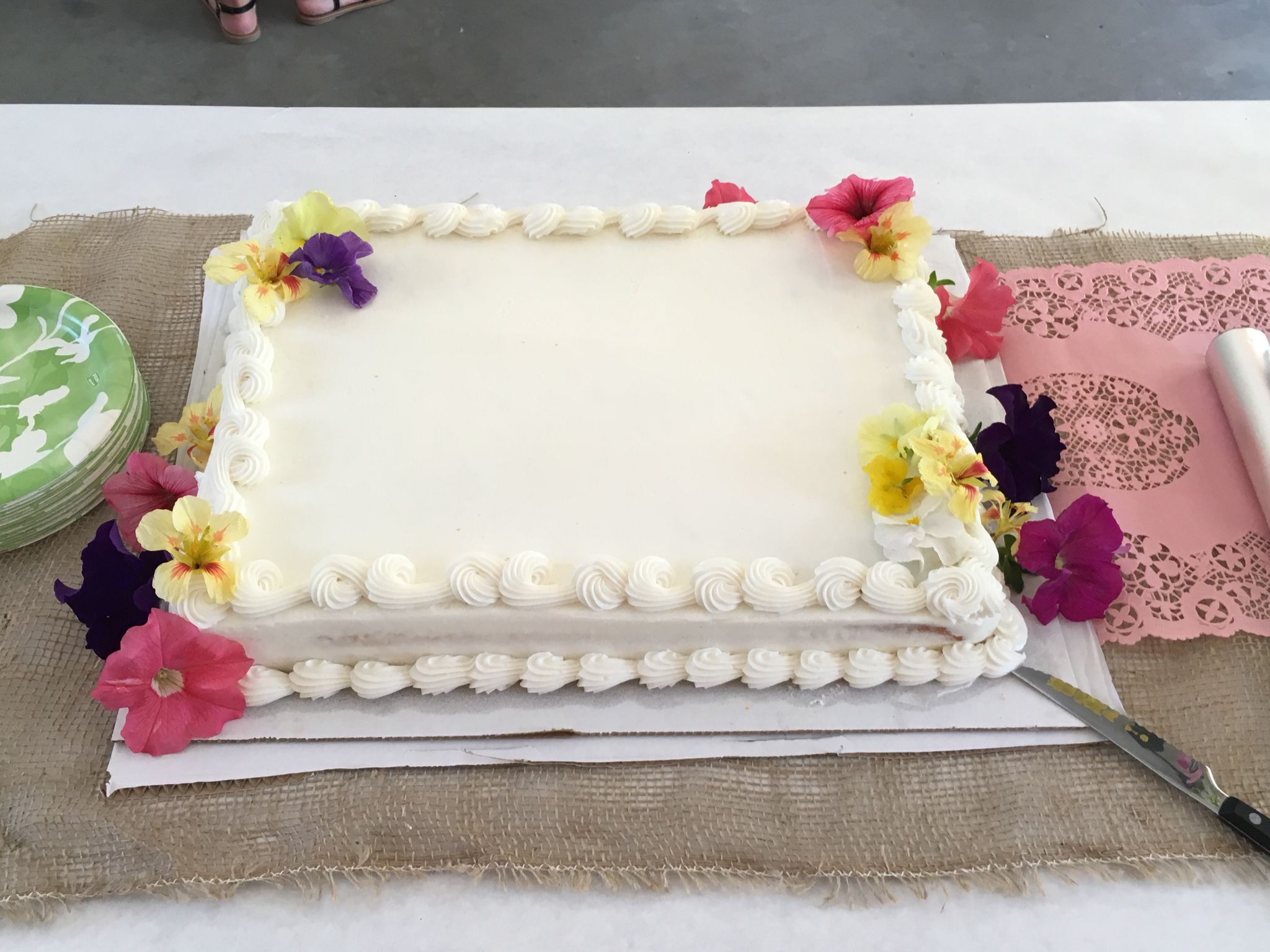 Costco white sheet cake with fresh flowers for graduation garden party