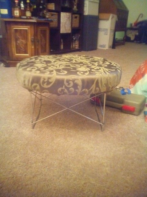 I made this old end table into and ottoman.
