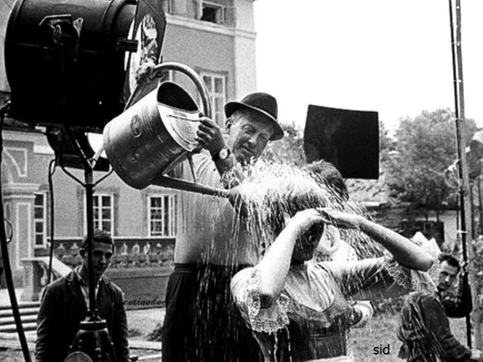 On set: The Sound of Music, 1965. Miss Andrews getting doused for the rowboat scene-
