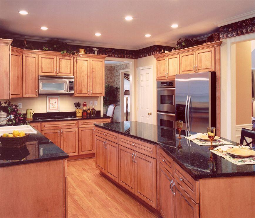 Kitchen With Granite Countertops And Hardwood Floors