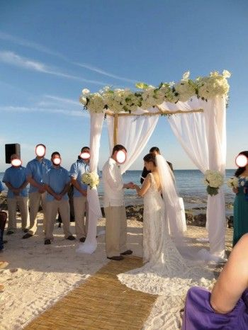 Love this altar!!  Trying to figure out how these brides deal with dragging their beautiful dresses and veils through the sand!